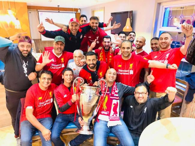 In Pictures: Liverpool fans celebrate with Champions League Trophy and giant cake at Kebabish