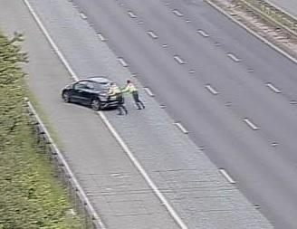 M60 crash. Traffic officers push car to side of road.