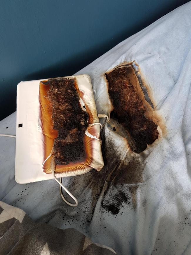 Warning after a tablet plugged in overnight did this to an 11-year-old's bed. Pic from Staffordshire Fire and Rescue Service