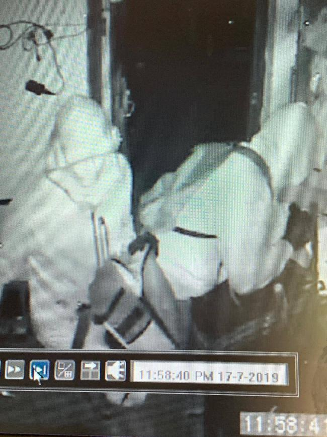 A CCTV still shows the offenders who broke into Radcliffe Borough Juniors FC's clubhouse