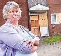 HE'S GONE: Susan Jacques outside her former neighbour's home. Francis Cullen played music at all hours