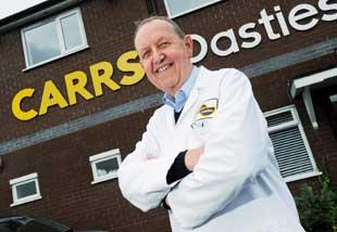 This Is Lancashire: PASTIE MAN: John Carr, managing director of Carrs Pasties, is proud of his product, baked in their thousands