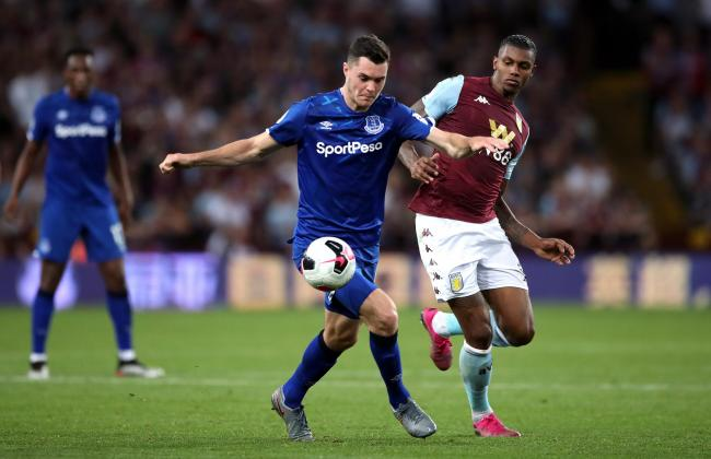 Michael Keane, left, will be back at Turf Moor on Saturday