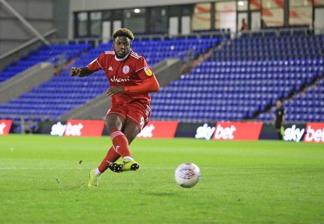 Offrande Zanzala scores from the penalty spot in Tuesday's 3-0 win against Oldham Athletic