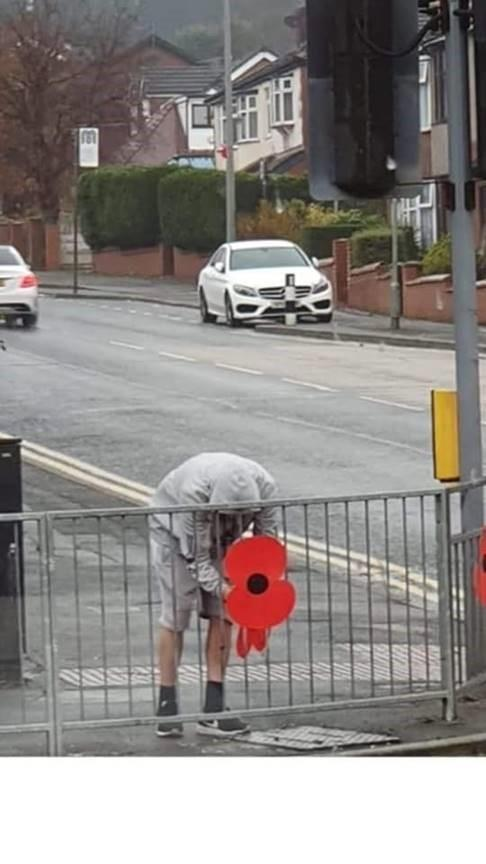 SHOCKING: A man was caught on camera stealing a poppy from Astley Bridge that was put along the route of Sunday's Remembrance March.