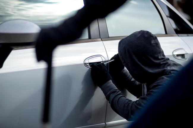 Generic image of a car thief
