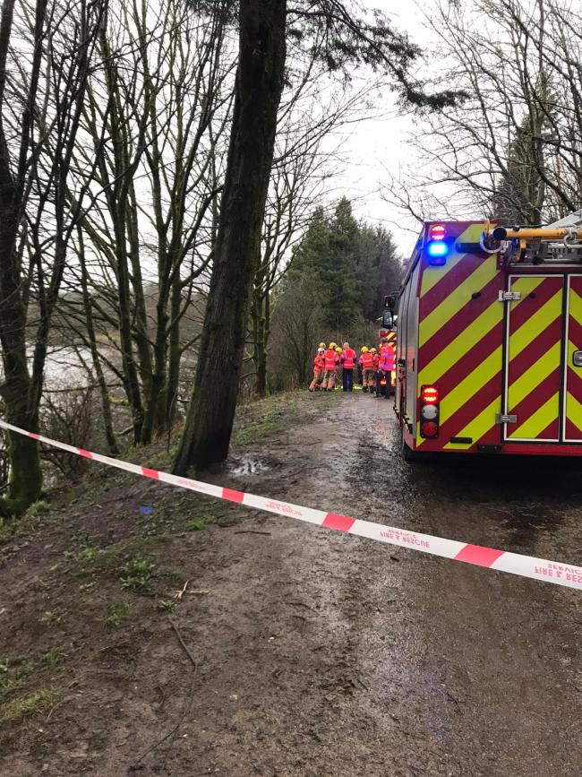 Firefighters rescue a woman at Jumbles Country Park