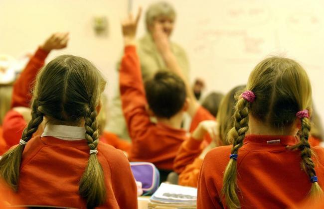 MPs and Bury's council leader have clashed over schools improvement funding