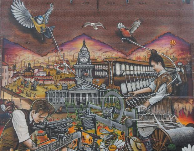 This Is Lancashire: The mural on Saville Street features details such as the town hall and Samuel Cromtpon's spinning mule