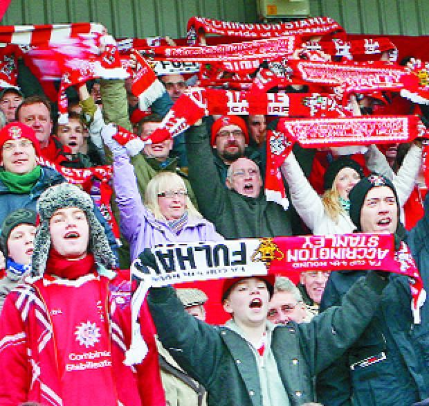 This Is Lancashire: CHEER WE GO: Accrington Stanley fans were out in force and in good voice as they cheered the Reds on during the FA Cup fourth round clash with Fulham at a packed Crown Ground                                                               Pictures: KIPAX