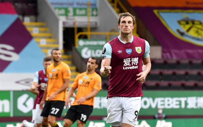 Burnley's Chris Wood celebrates scoring his side's first goal of the game during the Premier League match at Turf Moor, Burnley. PA Photo. Issue date: Wednesday July 15, 2020. See PA story SOCCER Burnley. Photo credit should read: Paul Ellis/NMC P