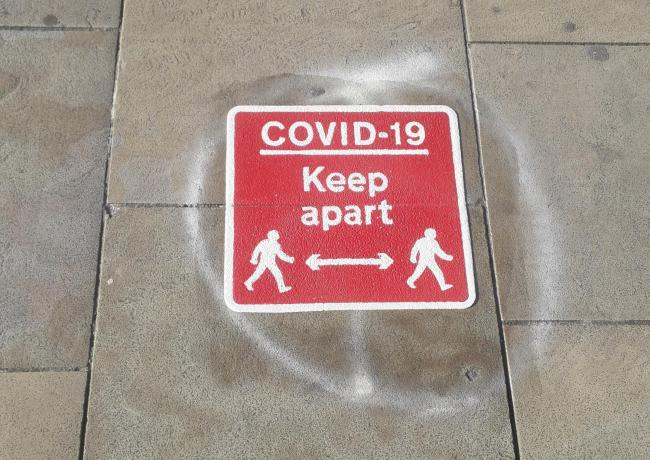 Coronavirus social distancing markings on the floor in Bolton