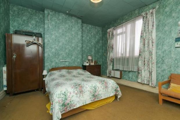 This Is Lancashire: A bedroom in the property (Photo: Zoopla)