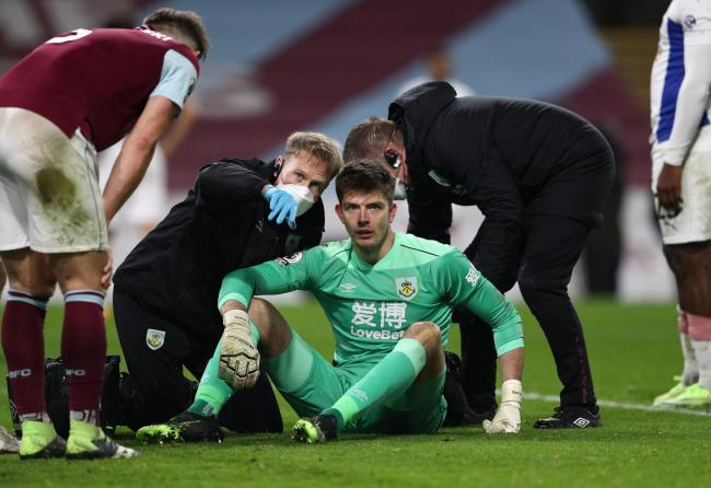 Burnley goalkeeper Nick Pope is treated at the end of the win over Crystal Palace