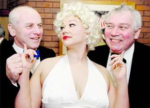 GALA: Paul Fenna, left, and Stephen Hughes get a tickle from Lisa-marie Hunt, alias Marilyn Monroe, at the dinner to celebrate the centenary of Blackburn's Thwaites Empire