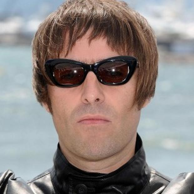 BACK: Liam Gallagher