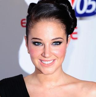 X Factor judge Tulisa has topped the charts with her single Young
