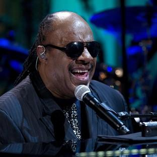Two people were charged after allegedly trying to sell embarrassing information about Stevie Wonder (AP/Carolyn Kaster)