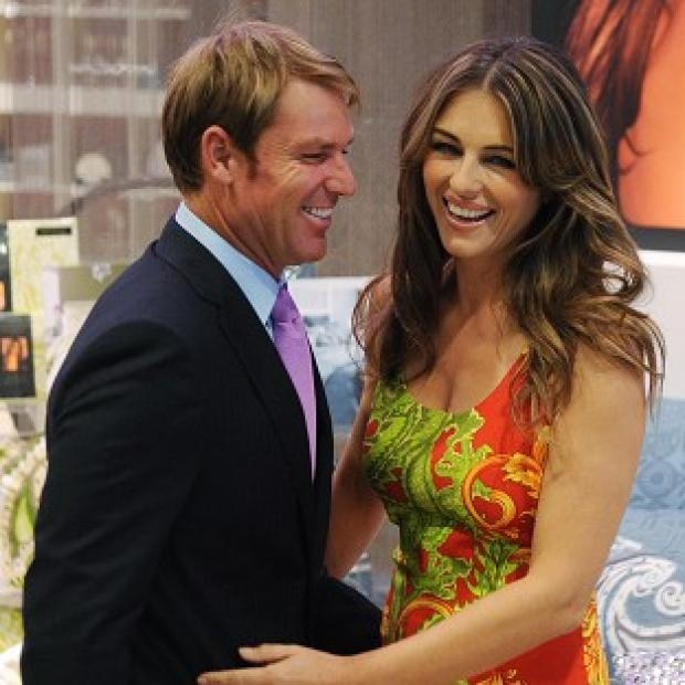 Liz Hurley's fiance Shane Warne helped her launch the collection