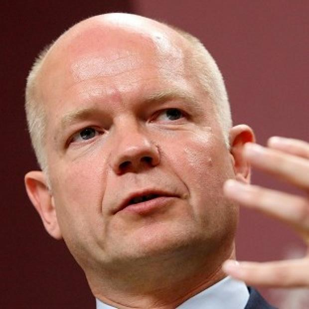 Foreign Secretary William Hague is calling for an urgent meeting of the UN Security Council over the Houla massacre