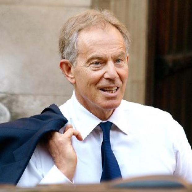Former prime minister Tony Blair arrives at the High Court to give evidence to the Leveson Inquiry into press standards