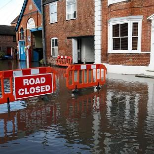 Torrential downpours have brought flooding to swathes of northern England