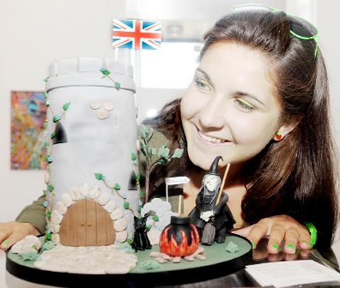 French tourist Anny Patton views a 'Witch Cake' at Clitheroe's Platform Gallery
