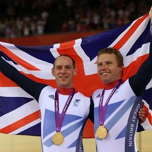 Anthony Kappes, left, and Craig Maclean celebrate winning gold in the men's individual B sprint
