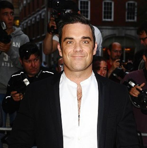 Robbie Williams said he is in a 'better place' these days