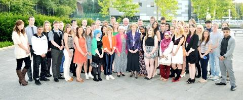 TOP CLASS The award winning students with dignitaries.