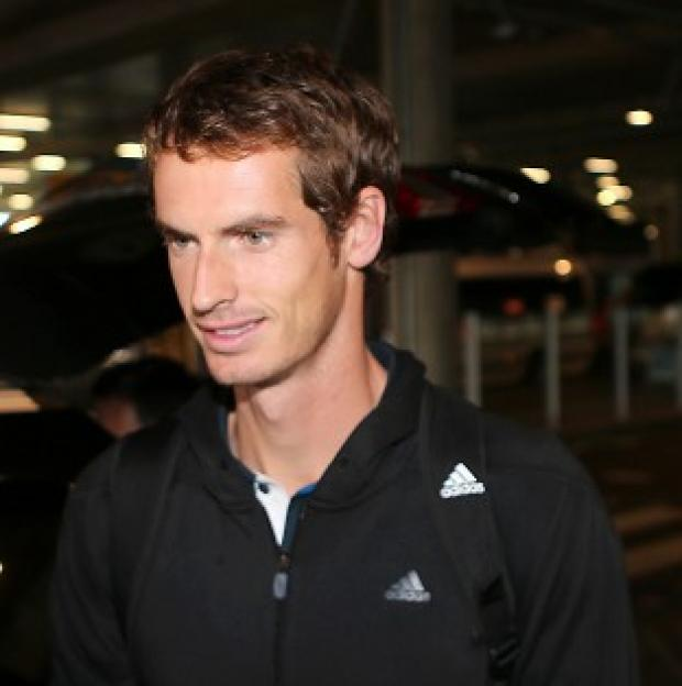 US Open winner Andy Murray arrives back at Heathrow Airport