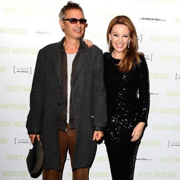 Leos Carax (left) and Kylie Minogue arriving at the Holy Motors UK Premiere at the Curzon Mayfair, London