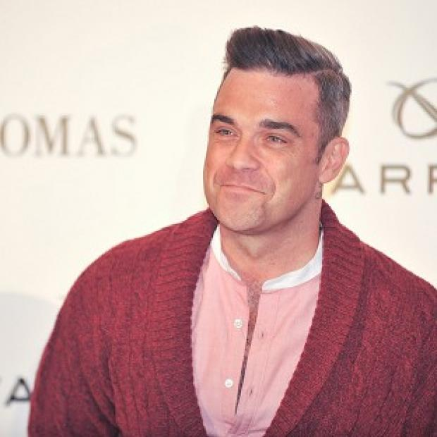 Robbie Williams says he is a fan of One Direction