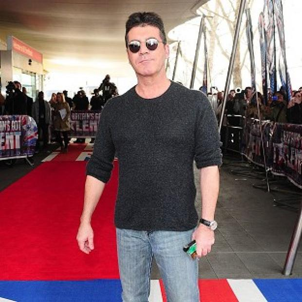 Simon Cowell has tweeted about having a healer in his home