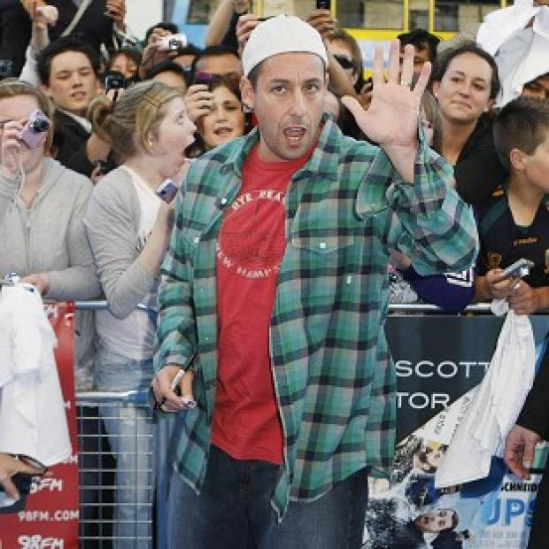 Adam Sandler says his daughters were impressed that he got to work with Selena Gomez