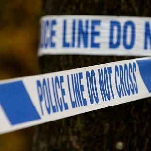 The three bodies were found next to a car on an Andover bridleway