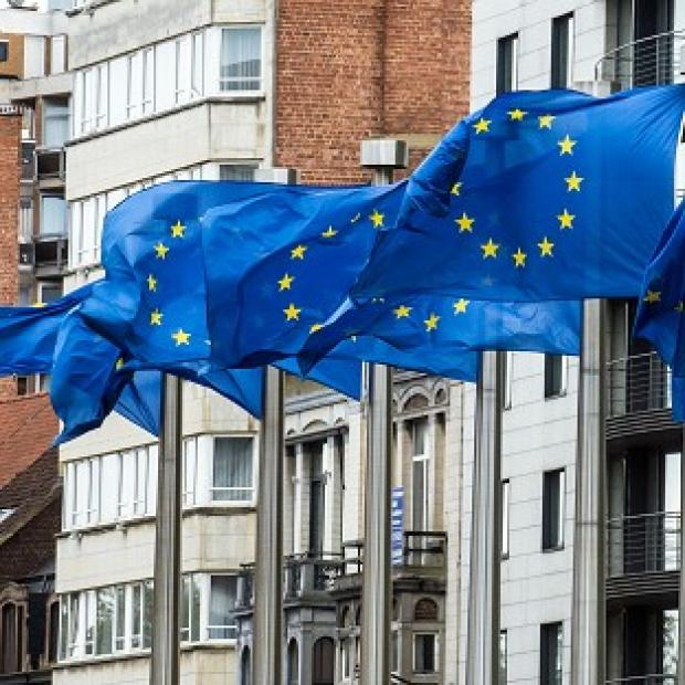 Flags wave at the European Commission headquarters in Brussels as it was announced the European Union has won the Nobel Peace Prize (AP)