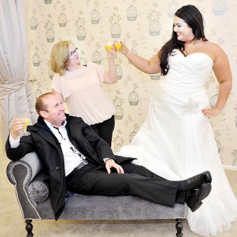 David Fishwick and Sarah Mottershead with Becky Hannon modelling a wedding dress