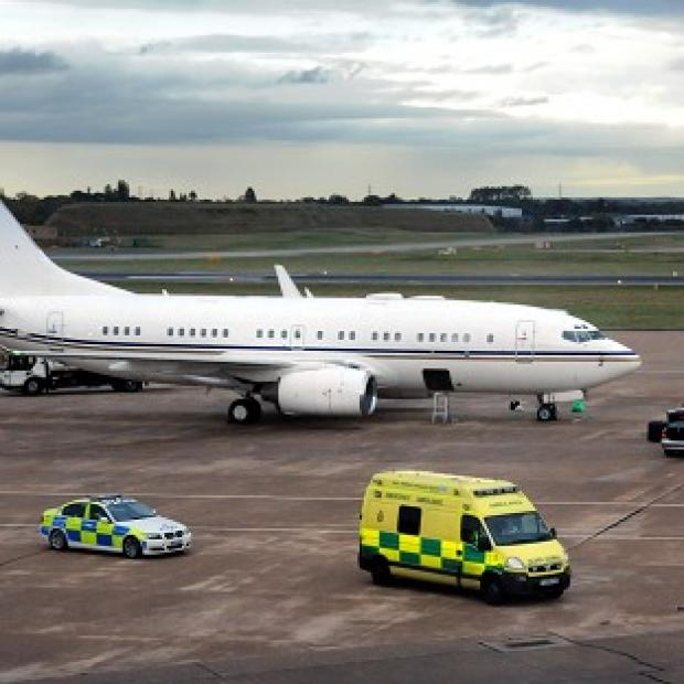 The plane containing Malala Yousafzai, who was shot in the head by Taliban gunmen, arrives in the UK