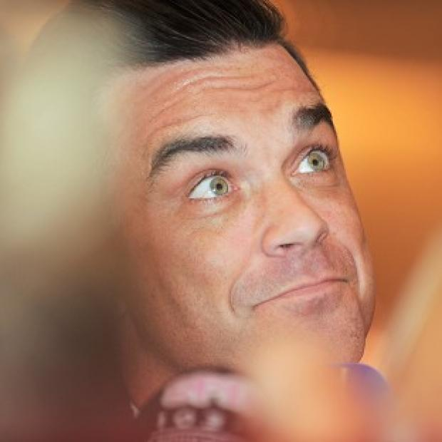 Robbie Williams is among the stars who will record a charity single