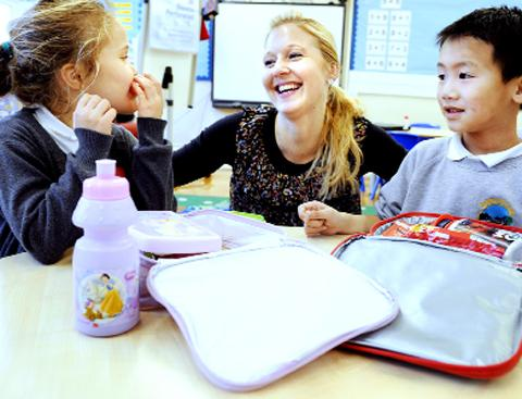 Catherine Savage with pupils Jessica Austin and Jackson Deng