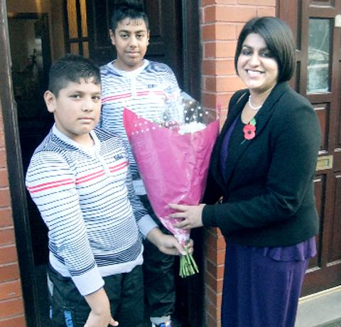 Bilal and Jamal present flowers to Shabana Mahmood MP during her visit