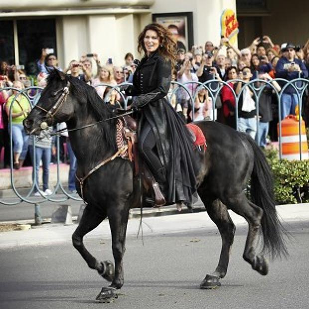 "Shania Twain makes her official arrival on horseback at Caesars Palace in Las Vegas on Wednesday, Nov. 14, 2012. Twain is set to begin a two-year residency at the Colosseum with her show ""Shania: Still the One"" starting Dec. 1. (AP Photo/Las Veg"