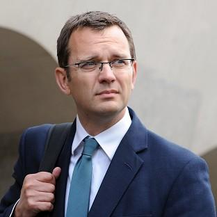 Former government spin doctor Andy Coulson will appear in court alongside ex-News International chief executive Rebekah Brooks