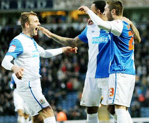 THREE WISE MEN Rovers trio of goalscorers Jordan Rhodes, Colin Kazim-Richards and Ruben Rochina celebrate the Spaniard's opening goal