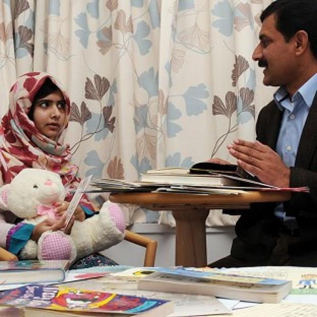 Malala Yousafzai with her father Ziauddin (Queen Elizabeth Hospital/PA)