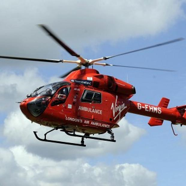 A 65-year-old man was airlifted to hospital after falling into flood waters when a bridge collapsed