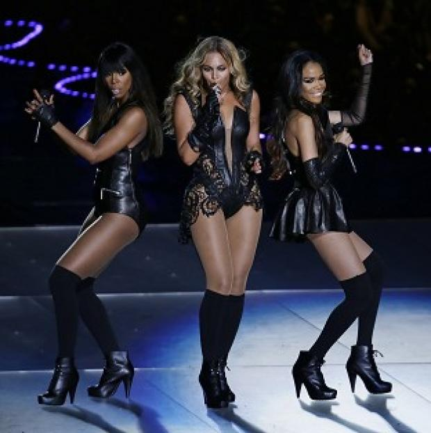 Beyonce performs with Kelly Rowland, left, and Michelle Williams (AP/Gerald Herbert)