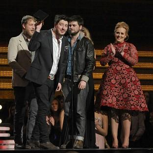 Mumford and Sons accept the award for album of the year for Babel from Adele at the 55th annual Grammy Awards (AP)