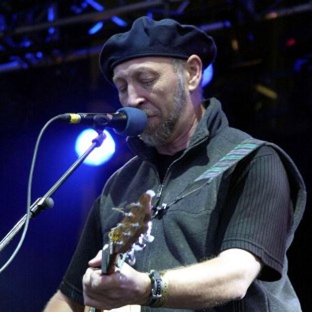 Folk rock guitarist and singer songwriter Richard Thompson performing on stage